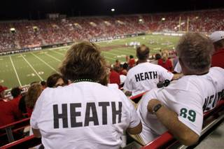 Friends and family of the Heath brothers: Jason of UNLV, and Brian of Sacramento St. watch the action Saturday night at Sam Boyd Stadium.