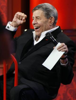 Jerry Lewis reacts happily to a tally update.