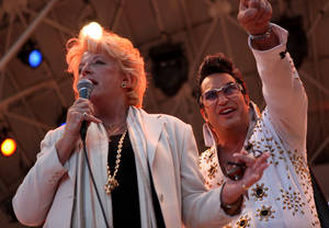Carolyn Goodman talks to the crowd with Elvis tribute artist Jesse Garon by her side as her and her husband of 47 years, Las Vegas Mayor Oscar B. Goodman, renewed their wedding vows Wednesday at the Fremont Street Experience in celebration of 9/9/09.