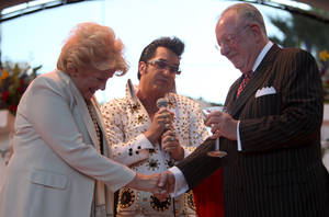 Elvis tribute artist Jesse Garon prays as Las Vegas Mayor Oscar B. Goodman and his wife of 47 years Carolyn Goodman renewed their wedding vows Wednesday at the Fremont Street Experience in celebration of 9/9/09.