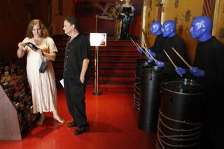 Lisa Striano and Tony Thompson of New York City look at brochures by figures of the Blue Man Group before their 9:09 a.m. wedding at Madame Tussauds Las Vegas Wednesday, Sept. 9, 2009. The wax museum offered free weddings or marriage vow renewals, then offered $99 wedding specials for the remainder of 09/09/09.