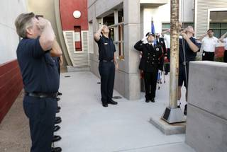 A flag that once flew over the World Trade Center is hoisted to half-staff Friday over a piece of steel from the World Trade Center as members of Las Vegas Fire & Rescue Station No. 5 joined in a remembrance of those who lost their lives in the terrorist attacks on Sept. 11, 2001.
