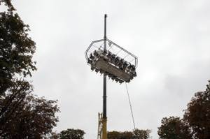 "The platform where guests are seated around a table  is suspended by a crane at a height of 50 meters above the Tuileries Garden, as part of the presentation of the event ""Dinner in the Sky"" in Paris, Friday, Sept. 11, 2009."