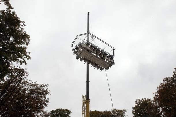 The platform where guests are seated around a table  is suspended by a crane at a height of 50 meters above the Tuileries Garden, as part of the presentation of the event