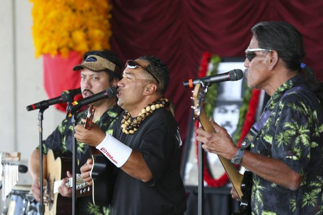 Jonathan Hoomanawanui, center, sings and plays the ukulele while performing with the Hula Halau O Kaumualii group Saturday at the Pacific Islands Festival at the Henderson Events Plaza.