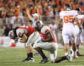 Malo Taumua (left) and Preston Brooks of UNLV drop after Oregon State kicked in the go-ahead field goal Saturday night at Sam Boyd Stadium. Oregon St. won the game 23-21.