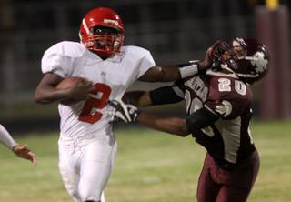 Tim Hasson of Cimarron-Memorial High, right, tries to bring down Taylor Wooten of Arbor View during a game last fall. Hasson, who finished 106 tackles in 2009, has impressed coaches during practices for Saturday's 39th Annual Lions Club all-star game. Hasson will walk-on at UNLV.