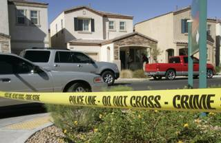 Metro Police investigate at the scene of an apparent murder-suicide at 1292 Sun Village Ave. Monday, September 14, 2009.