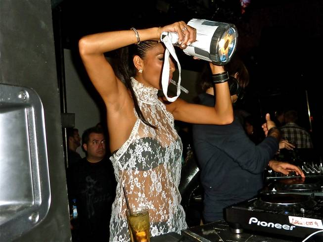 Pussycat Dolls lead singer Nicole Scherzinger playfully scans the crowd at Rain on Sept. 12 using a high-powered flashlight.