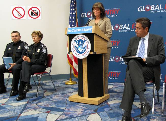 Clark County Deputy Director of Aviation Rosemary Vassiliadis speaks at a press conference to show off the new Global Entry kiosks at McCarran International Airport's Terminal 2 on Wednesday. Looking on are, from left, Sergio Espinoza, Los Angeles assistant port director, Debbie Sanders, McCarran area port director, and Carlos Martel, Los Angeles area port director.
