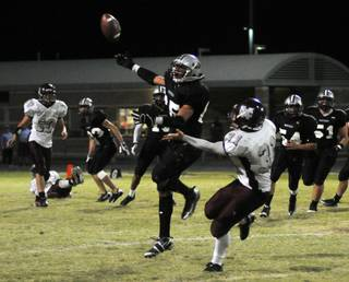 A Panthers linebacker deflects a pass intended for Spartans running back Zach Barbara late in the fourth quarter at Palo Verde High School on Thursday night.