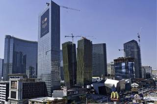 Eco-friendly resorts: Construction continues on the CityCenter on the Strip between Monte Carlo and Bellagio. Aria and Vdara were given the second-highest certification by the U.S. Green Building Council.