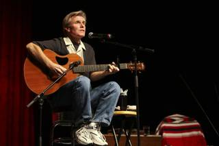 Musician Steve Cottrell entertains audience members with folk tunes such as