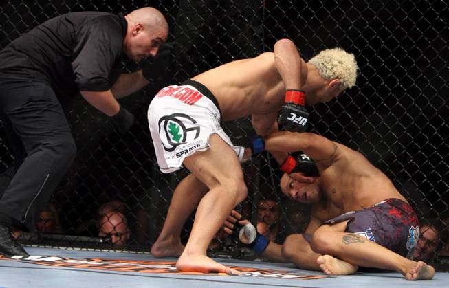 Josh Koscheck (red) prepares to hit Frank Trigg (blue) in a fight at UFC 103 at American Airlines Center in Dallas. Koscheck defeated Trigg.