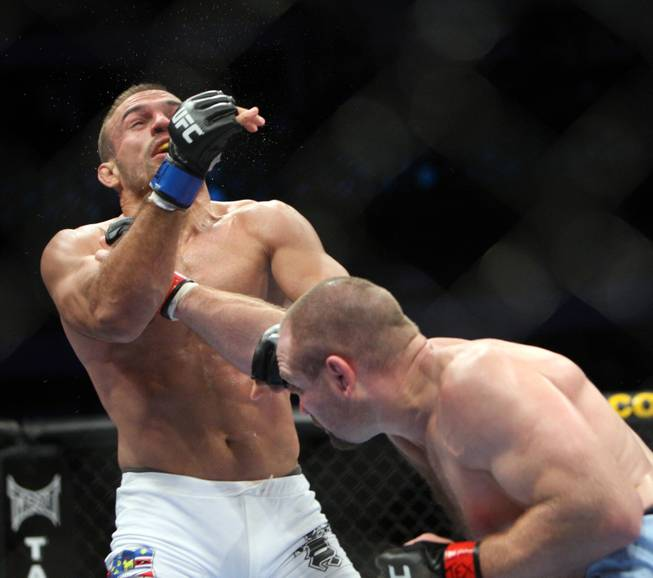 Vladimir Matyushenko (red) hits Igor Pokrajac (blue) in a fight at UFC 103 at American Airlines Center in Dallas tonight.