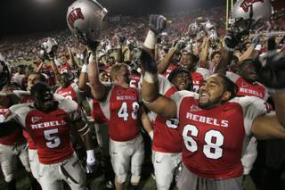 UNLV players celebrate their 34-33 defeat of Hawaii.
