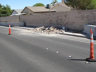 Debris from construction work to rebuild a block wall along Whitney Ranch Drive spills out into the street. Residents in the area have expressed concern about the buildup of piles like this one.