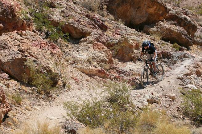 Sam Scheller spends an afternoon riding his mountain bike along the rugged terrain of Bootleg Canyon bike trails near Boulder City in May 2007.