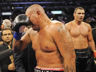 Chris Arreola, of Riverside, Calif., left, weeps after losing by TKO in the 10th round of his bout against World Boxing Council heavyweight champion Vitali Klitschko, right, in their WBC heavyweight title boxing match Saturday, Sept. 26, 2009, in Los Angeles.