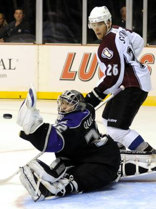 Colorado center Paul Stastny (26) waits for a possible rebound as Los Angeles Kings goaltender Jon Quick deflects a shot with his glove during Frozen Fury XII at the MGM Grand Garden Arena on Saturday night.