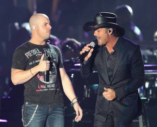 Chris Daughtry and Tim McGraw perform during the Andre Agassi Foundation for Education's Grand Slam for Children benefit concert at Wynn Las Vegas Sept. 26, 2009.