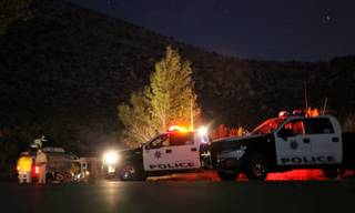 Metro Police and other agencies respond to Mount Charleston on Sunday evening to investigate a helicopter crash that injured three people.