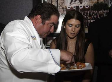 Emeril Lagasse and Danica Patrick at Lagasse's Stadium in the Palazzo.