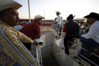 Mexican cowboys wait for the next bull rider during a Hispanic Cultural Events Rodeo at rodeo grounds by the vacant Roadhouse Casino on Boulder Highway near Sunset Road in Henderson Sept. 26, 2009. The rodeo was the first of what is to be a weekly rodeo held from 3 p.m. to 9 p.m. each Saturday through Oct. 17.