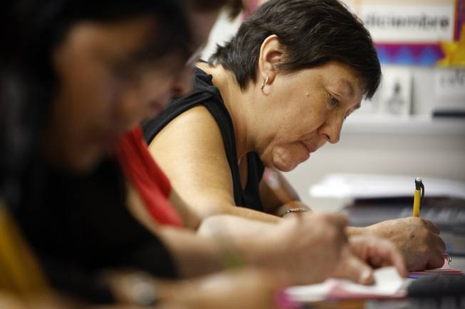 Maria De Jesus Esparza Castillo, 57, works on a writing exercise during a free class Tuesday, Sept. 22, 2009. A school district program with private foundation money uses Mexican government-supplied materials to teach functionally illiterate parents to read and write in Spanish.