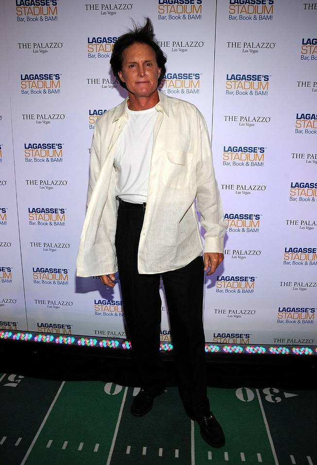 Bruce Jenner, stepfather of Khloe Kardashian, walks the red carpet Friday, Sept.25, at the opening of Emeril Lagasse's Stadium eatery at the Palazzo hotel and casino in Las Vegas.