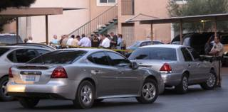 Metro Police investigate after an officer fatally shot a teenage boy Tuesday night in the eastern Las Vegas Valley. Authorities said he held a knife to a woman's throat.