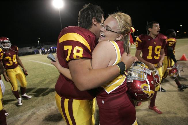 Del Sol cheerleader Stevie Scott hugs Roque Covarrubias after defeating ...