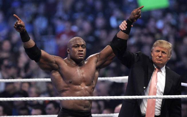 Donald Trump raises the arm of wrestler Bobby Lashley after he defeated Umaga at Wrestlemania 23 at Ford Field in Detroit, Sunday, April 1, 2007.