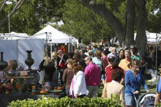 Hundreds of people ventured into the whipping winds around Bicentennial Park to admire the art Sunday during the 47th Annual Art in the Park in Boulder City.