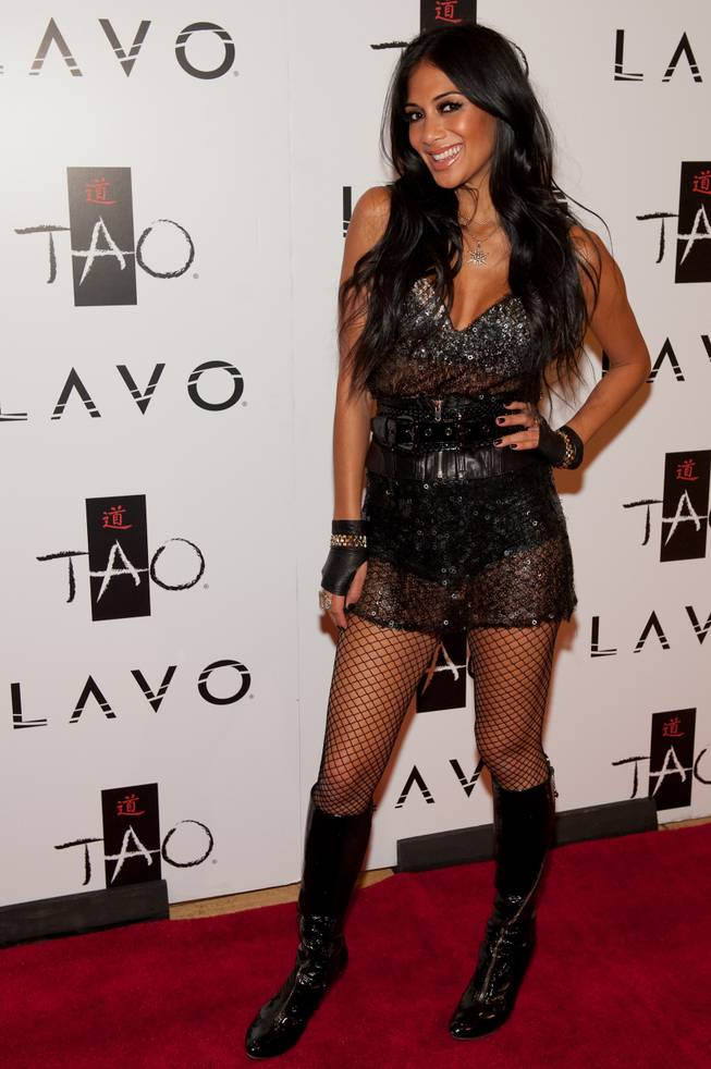 Nicole Scherzinger walks the red carpet at the Tao anniversary celebration Saturday, Oct. 3, 2009, in Las Vegas.