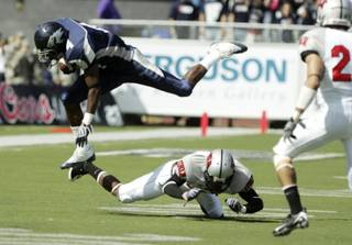 UNR's Brandon Wimberly leaps over UNLV's Travis Dixon during the first half in Reno at Mackay Stadium on Saturday, Oct. 3, 2009.