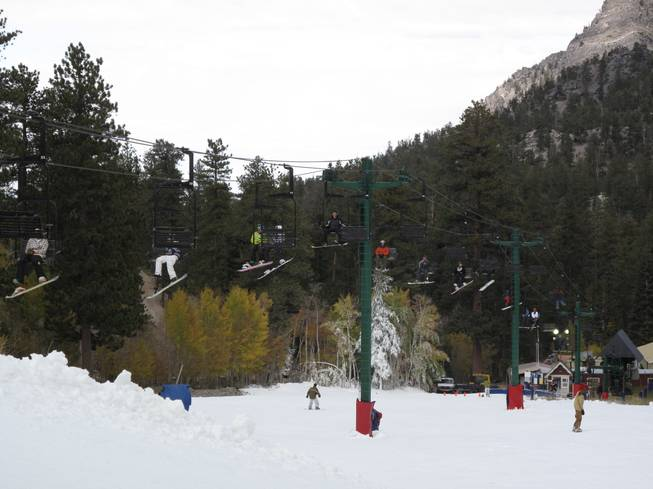 Snowboarders and skiers ride a packed ski lift  to the top a beginner slope at the Las Vegas Ski and Snowboard Resort near Mount Charleston. The resort opened at noon on Wednesday, making it the second ski area in the lower 48 states to open this year.