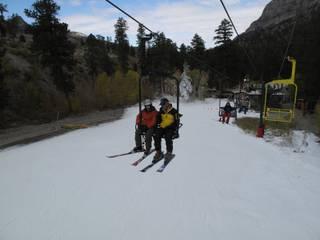 A couple of skiers chat as they ride up chairlift on the beginner hill at the Las Vegas Ski and Snowboard Resort near Mount Charleston. The resort opened at noon on Wednesday, making it the second ski area in the lower 48 states to open this year.