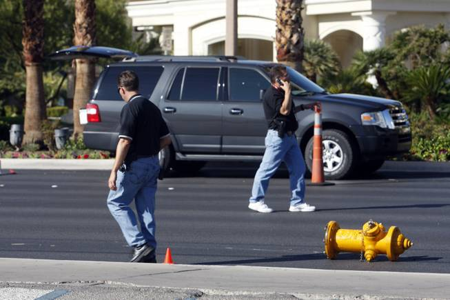 Investigators walk by a fire hydrant after a auto-pedestrian accident involving a 9-year-old boy on Las Vegas Boulevard South near Mandalay Bay on Thursday, Oct. 8, 2009.