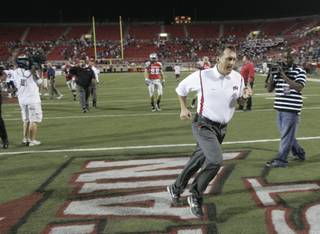 UNLV head coach Mike Sanford sprints off the field after a 59-21 loss to BYU Oct. 10 at Sam Boyd Stadium.