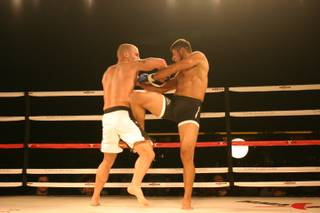 Odiz Ruiz delivers a knee to opponent Mike Dizak during MMA Xplosion at the M Resort.