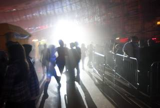 Guests walk through fog and strobe lights in the Fright Dome at Circus Circus Friday, Oct. 9, 2009.