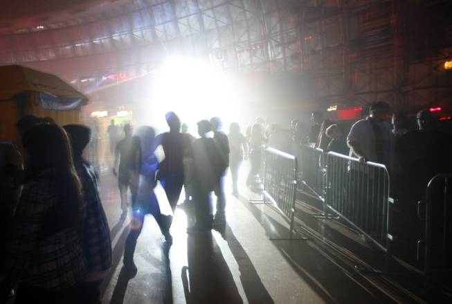 Guests walk through fog and strobe lights in the Fright ...
