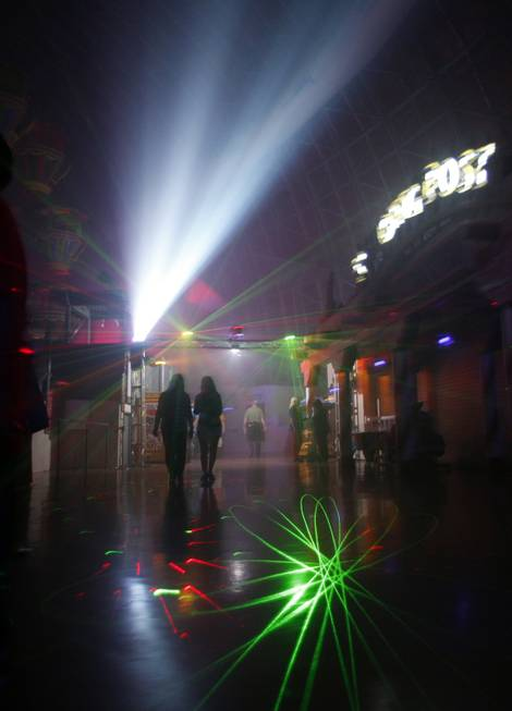 Guests walk through fog and lasers in the Fright Dome ...