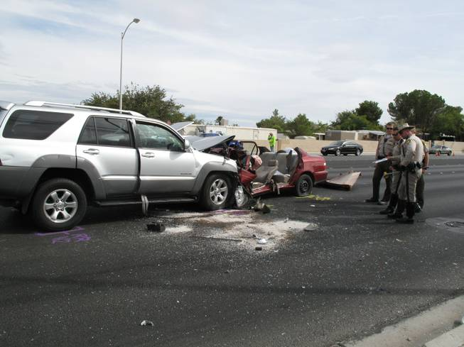 Metro Police investigate a car crash near the intersection of Jones Boulevard and Tropicana Avenue. The accident occurred at about 12:15 p.m. on Tuesday.