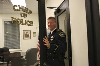 Police Chief Thomas Finn opens the door to his office while conducting a tour Wednesday of the newly renovated police station.