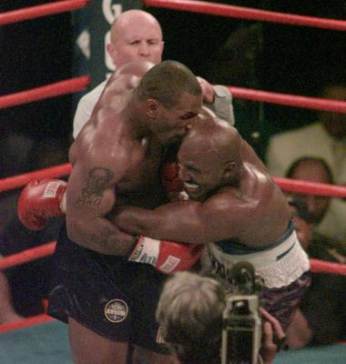 Mike Tyson bites into the ear of Evander Holyfield in the third round of their WBA Heavyweight match Saturday, June 28, 1997, at the MGM Grand in Las Vegas.