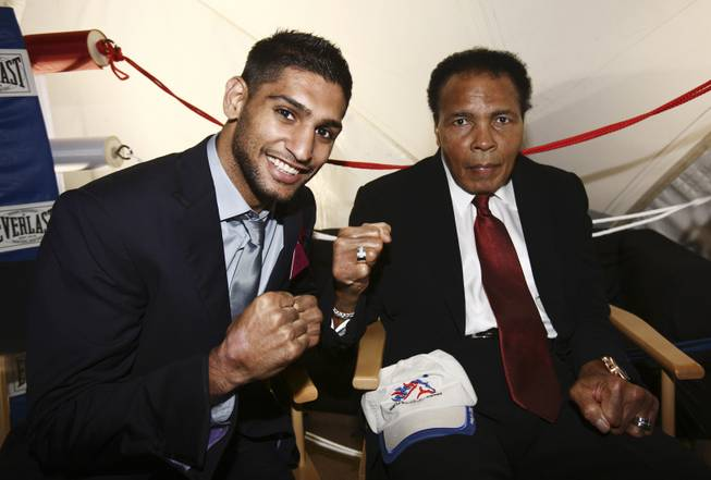 Muhammad Ali, right, and Amir Khan at the European Jumping and Dressage Championships in Windsor, England, on Friday, Aug. 28, 2009. The appearance is part of a weeklong tour of the United Kingdom and Ireland to help promote Ali's charitable work.