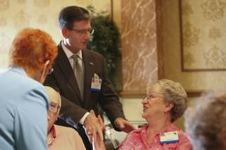 Former state Sen. Joe Heck, a Republican candidate for Congress, greets Judy Kidd during a luncheon hosted by the Boulder City Republican Women on Thursday at Railroad Pass Casino.  Heck is running for the seat currently held by U.S. Rep. Dina Titus (D-Nev.).