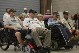 Resident of the Nevada State Veterans Home in Boulder City attend the dedication ceremony of the 5,400-square-foot new maintenance facility Thursday at the Veterans Memorial Cemetery in Boulder City.